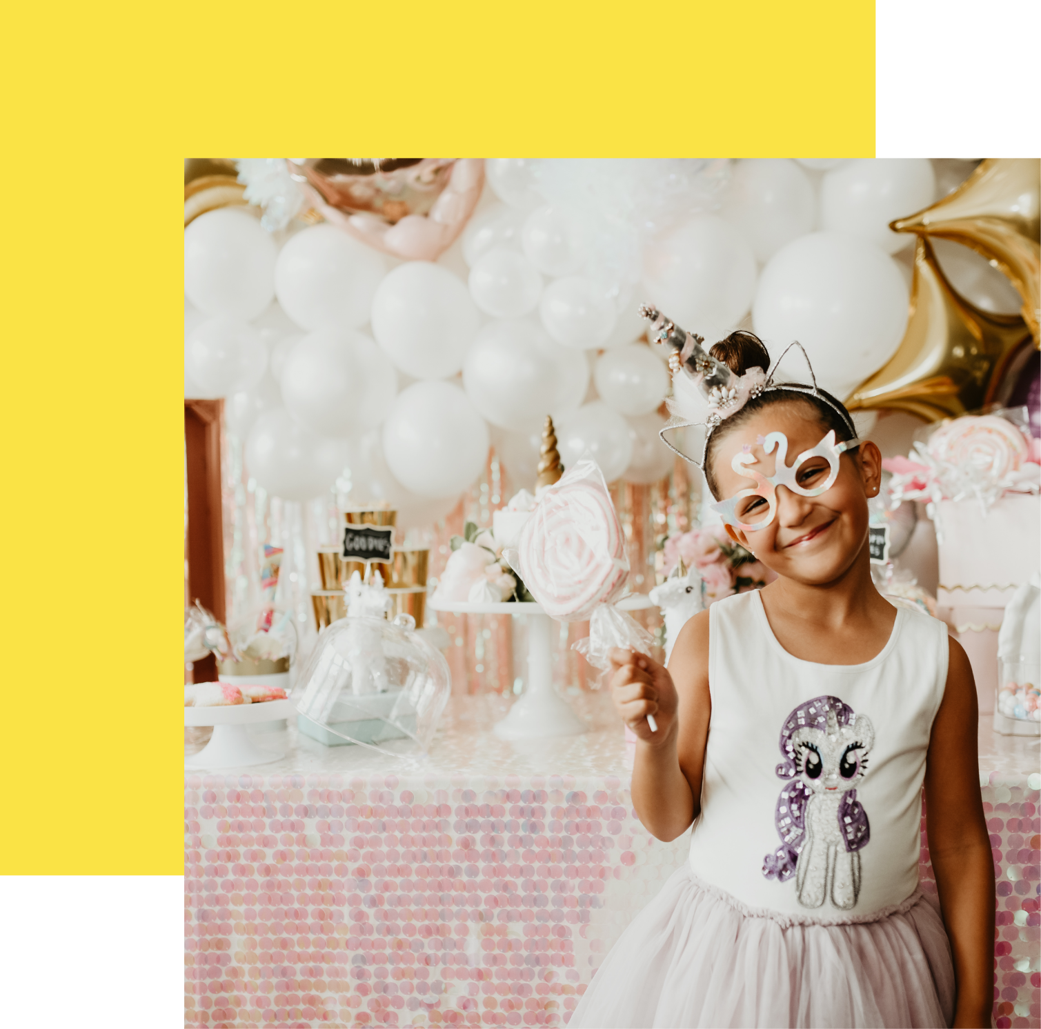 Girl with mask in front of party table